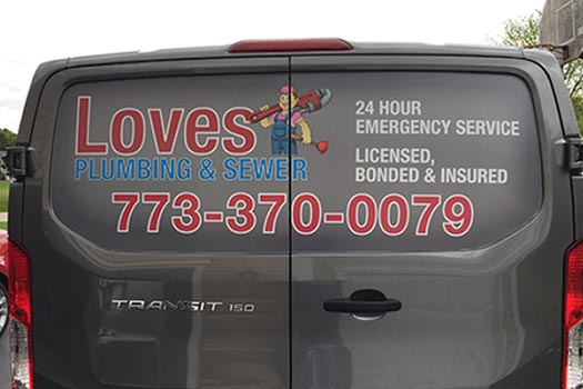 Custom Vinyl Lettering on Back of Van for Loves Plumbing