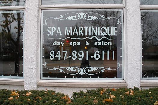white vinyl lettering on the inside of glass for spa martinique